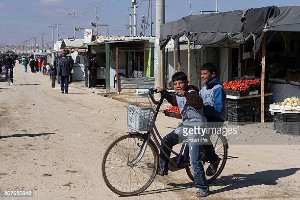 Syrian refugees children ride a bike in a street on February 2 2016 in the Zaatari camp in northeast Jordan King Abdullah of Jordan has said the huge...