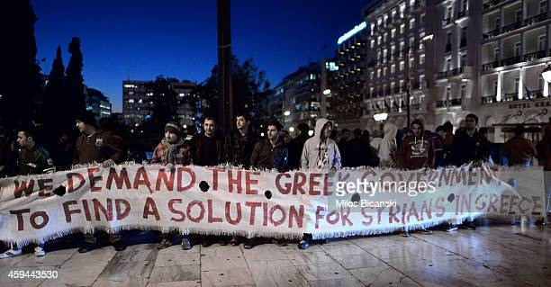 Syrian refugees conduct a silent protest outside of Parliament on November 22 2014 in Athens Greece Greece has seen a sharp rise in the number of...