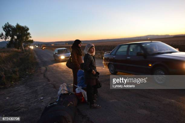 Syrian refugees cross into Turkey after the Muslim Holiday of Eid alAdha through unofficial border crossings in villages around Reyhanli and Hacipasa...