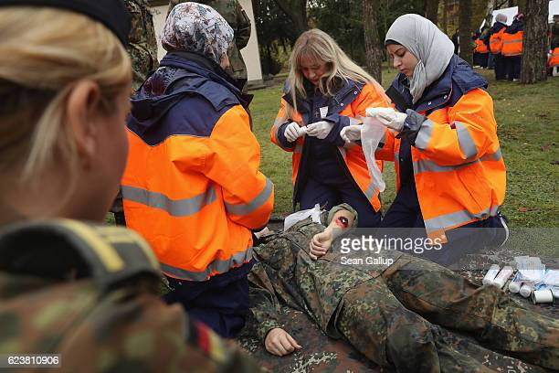Syrian refugees demonstrate skills they have learned in a first aid training program sponsored by the Bundeswehr for Syrian female refugees during a...