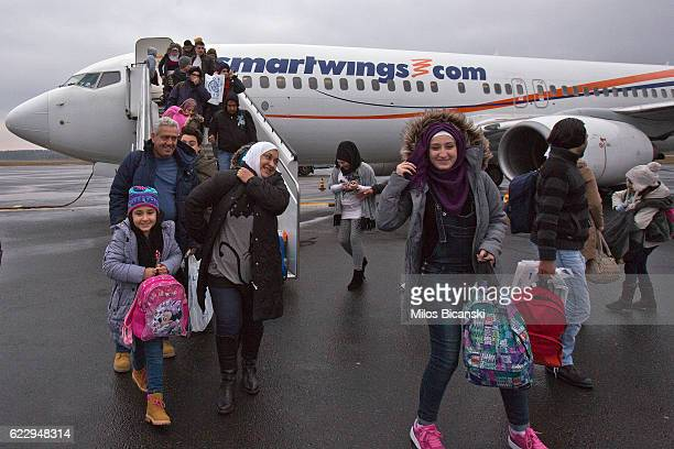 Syrian refugees disembark from their plane as the Asaaid Alkhateb family shows their relief and happiness after arriving from Athens Greece at...