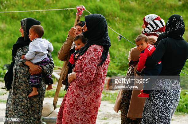 Syrian refugees fled from the civil war are seen in front of makeshift tent in Izmir Turkey on March 25 2016