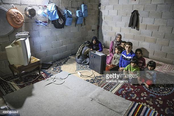 Syrian refugees fled their country due to the ongoing civil war are seen at a house that they share with other Syrian families in the Reyhanli...