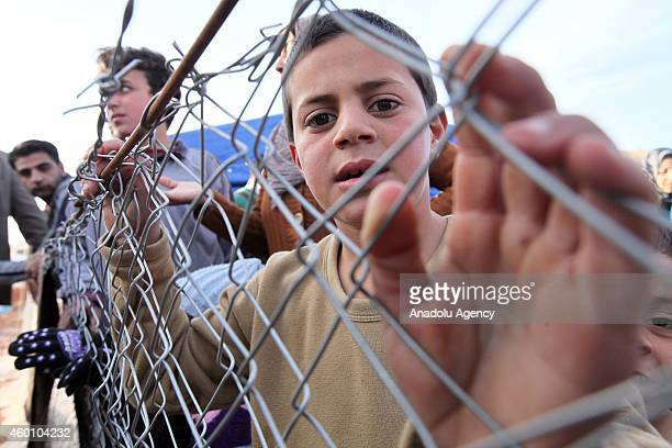 Syrian refugees fled their homes due to the civil war in their country try to hold on life under tough living conditions at Babel refugee camp in...