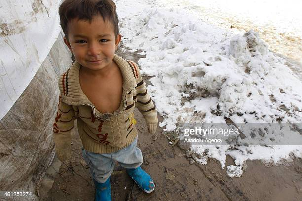 Syrian refugees fled their homes due to the civil war in their country try to live under harsh living conditions at a refugee camp in Beirut Lebanon...
