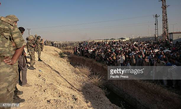 Syrian refugees flee to the Turkish border to escape fighting as Kurdish forces advance to the outskirts of the Syrian town of Tal Abyad held by the...