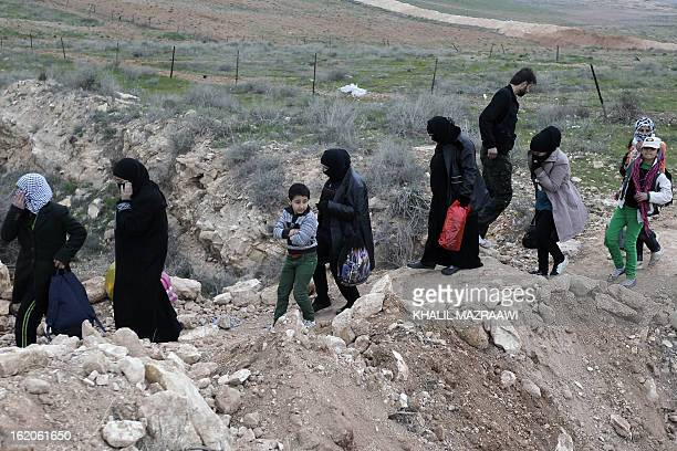 Syrian refugees fleeing violence in their country cross into Jordanian territory near Mafraq on the border with Syria on February 18 2013 Jordan says...