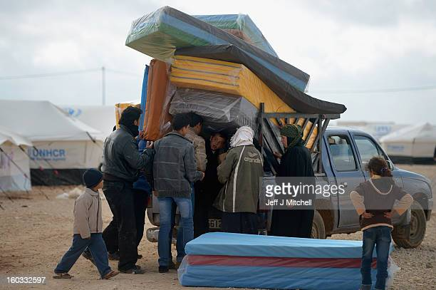 Syrian refugees go about their daily business in the Za'atari refugee camp on January 29 2013 in Mafrq Jordan Record numbers of refugees are fleeing...