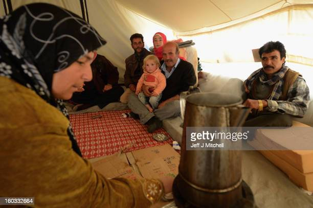 Syrian refugees go about their daily business in the Za'atari refugee camp on January 29 2013 in Mafraq Jordan Record numbers of refugees are fleeing...