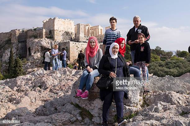 Syrian refugees Hassan and Lama Asaaid Alkhateb pose with their children Doha Sham Fatima and Mohamed for a photograph in front of Acropolis Hill the...