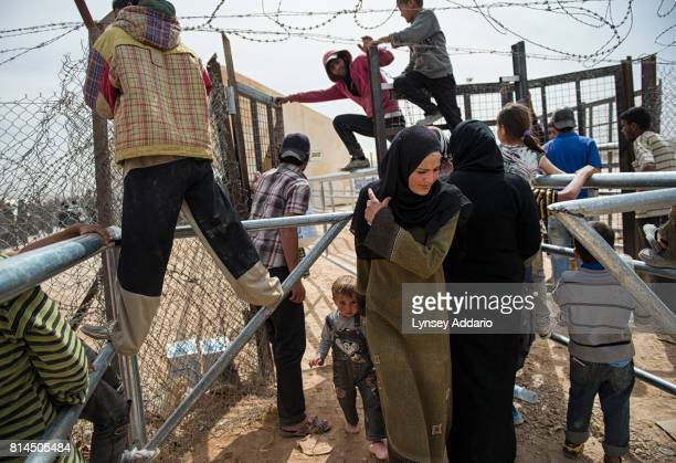 Syrian refugees leave a food distribution administered by the World Food Program and UNICEF at the Zaatari refugee camp in Jordan April 7 2013...