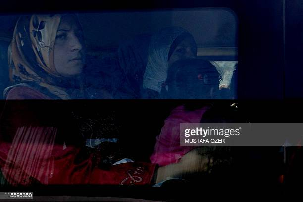 Syrian refugees leave on a bus on June 8 2011 the Yayladagi Turkish Red Crescent camp near the Turkish city of Hatay Turkey will not close its doors...