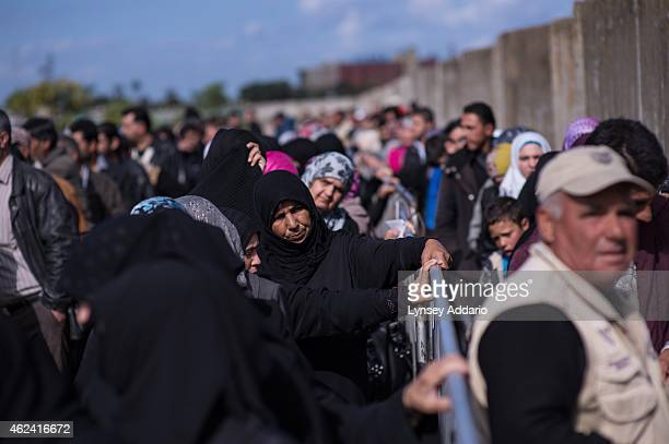 Syrian refugees line up to register or renew their registration at the UNHCR compound in Tripoli in North Lebanon March 11 2014 Lebanon a country of...