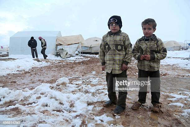 Syrian refugees living in a camp near Esselame Border Gate struggle to survive in harsh winter conditions in the Syrian town of Azaz on the outskirts...