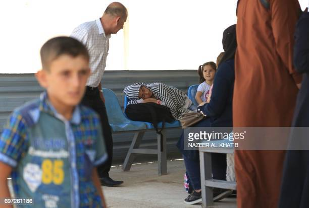 Syrian refugees living in Turkey wait to register at the Bab alSalama crossing near the city of Azaz in northern Syria on June 18 after Turkish...