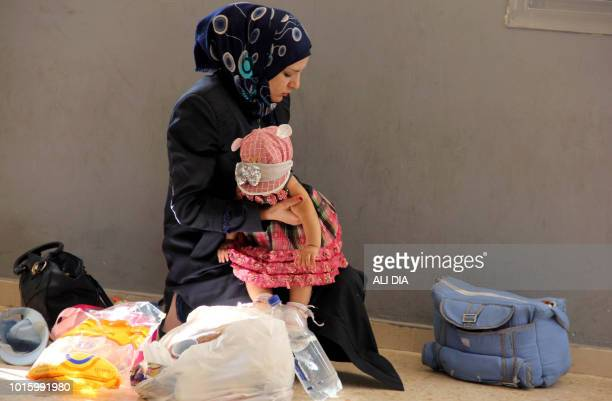 Syrian refugees prepare to be evacuated from the southern Lebanese village of Shebaa back to Syria on August 13 2018 Lebanon says it currently hosts...