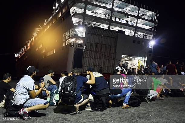Syrian refugees prepare to board the passenger ship 'Eleftherios Venizelos' at Kos's main port on August 16 2015 in Kos Greece The vessel will house...
