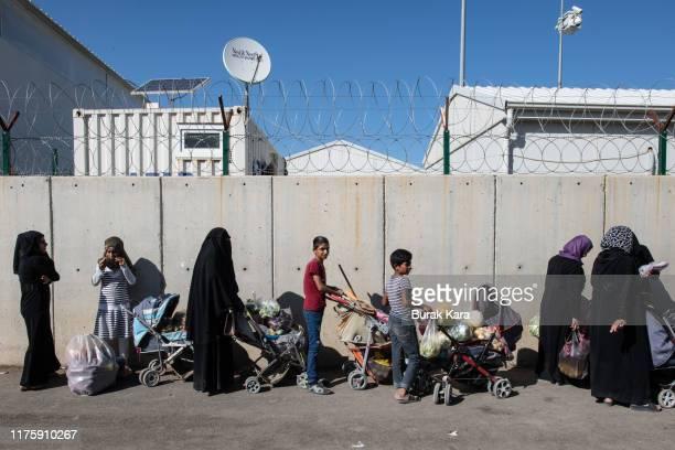 Syrian refugees queue to enter to the Kahramanmaras refugee camp on September 19, 2019 in Kahramanmaras, Turkey. Turkey's president, Recep Tayyip...