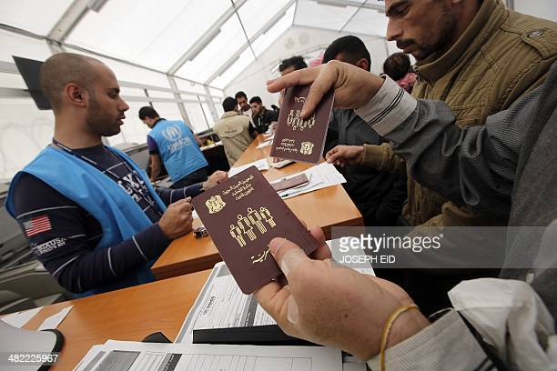 Syrian refugees queue up at a UNHCR registration center one of many across Lebanon in the northern port city of Tripoli on April 3 2014 More than one...