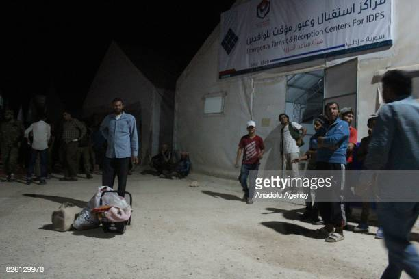 Syrian refugees return their homes after Ahrar alSham and Hezbollah announced a ceasefire in Idlib Syria on August 03 2017 First batch of 7 thousand...