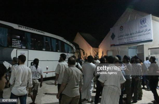 Syrian refugees return their homes with a bus after Ahrar alSham and Hezbollah announced a ceasefire in Idlib Syria on August 03 2017 First batch of...