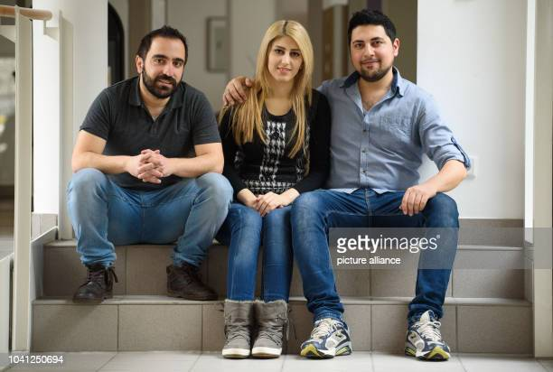Syrian refugees Saad Saad Siba Wardeh and her husband Okba Kerdiea pose in a nursing home in HofGermany 15 March 2016 Three refugees from Syria are...