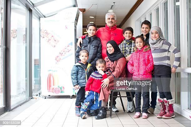 Syrian refugees Said Mohamad AlSarji , Mohamad Ali al Ahmed AlSarji, Ahmad , Abdulrahman , Dalaa , Hasan , Hussein , Fatima and Walaa photographed at...