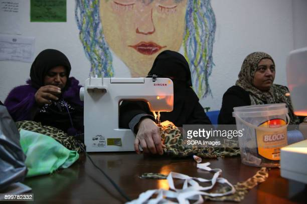 Syrian refugees sew at a women's centre run by the International Rescue Committee in Mafraq close to the SyrianJordan border There are currently over...