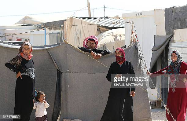 Syrian refugees stand at the Zaatari refugee camp located close to the northern Jordanian city of Mafraq near the border with Syria on July 14 2016...