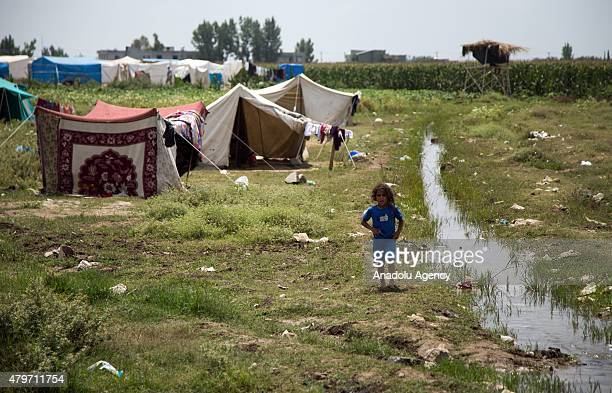 Syrian refugees try to hold on life under harsh living conditions at a refugee camp in Koza neighborhood of Adana Turkey on July 06 2015