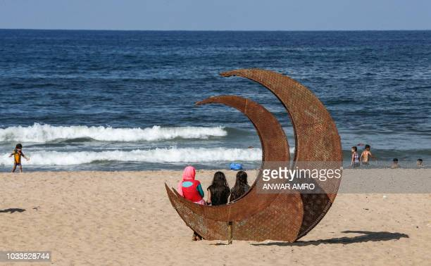 TOPSHOT Syrian refugees visit a public beach in the Lebanese capital Beirut's Ramlet alBaida neighbourhood on September 15 2018