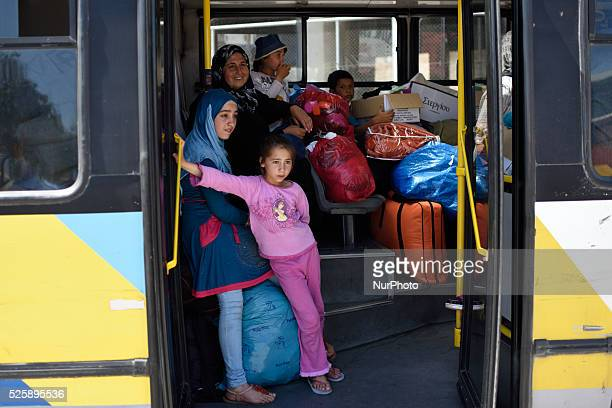 Syrian refugees wait in a bus in Pireas Port Athens in order to be transfered to Skaramagas Camp on April 28 2016 Some thousands of refugees are...