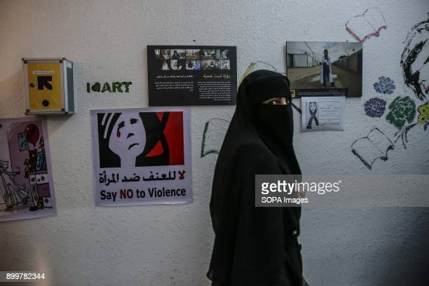 Syrian refugees walks through a women's centre run by the International Rescue Committee in Mafraq close to the SyrianJordan border The centre runs...