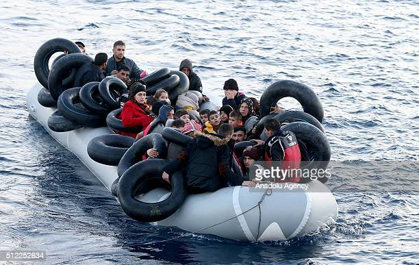 Syrian refugees who tried to go to Greek Island Chios are seen in a boat after they were caught by Turkish Coast Guard ship TCSG Umut near the...