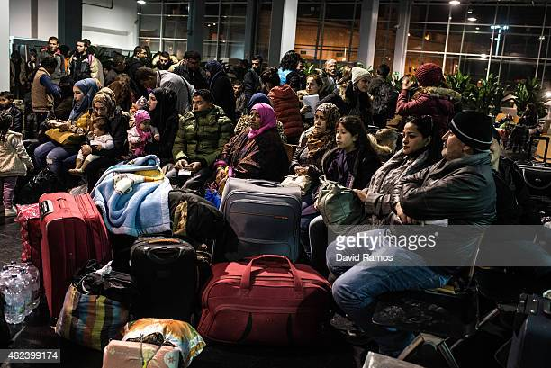 Syrian refugees who were staying at the Temporary Immigration Centre wait for getting their passports and tickets at the the Ferry Terminal of...