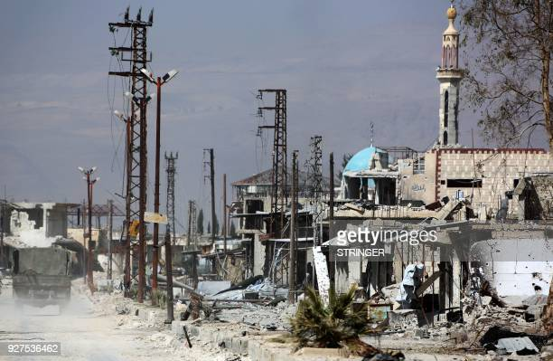 Syrian regime forces enter the village of Utaya on March 5 as they seized more ground in a fierce offensive to retake the battered rebel enclave of...