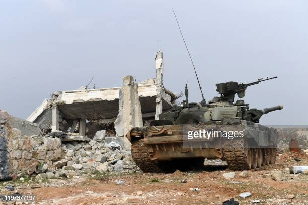 Syrian regime forces equipped with tanks man a position on the outskirts of the town of Khan Tuman in the northern Syrian Aleppo province on January...