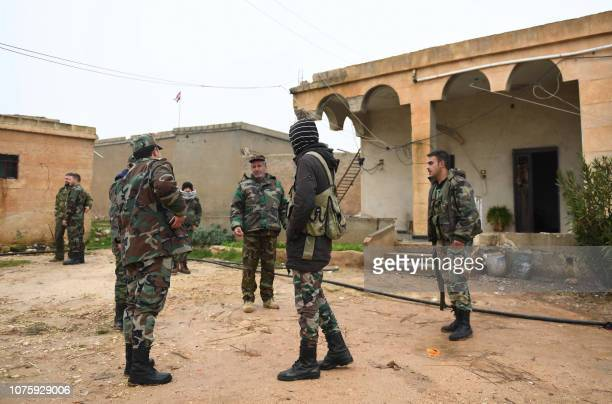 Syrian regime forces gather in the southern countryside of the northern Kurdishcontrolled city of Manbij on December 30 2018 The unexpected US...