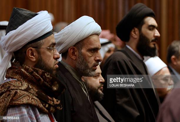 Syrian religious clerics attend the forum of Humat Qassyoun and Syrian Tribes in Damascus on January 16 2014 Syrian Minister of State for National...