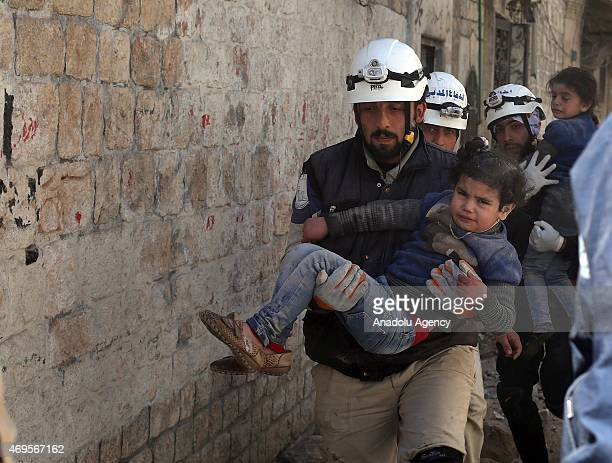 Syrian rescue worker carries a girl injured during the airstrikes of Syrian regime forces on the oppositioncontrolled alMaadi neighbourhood of Aleppo...