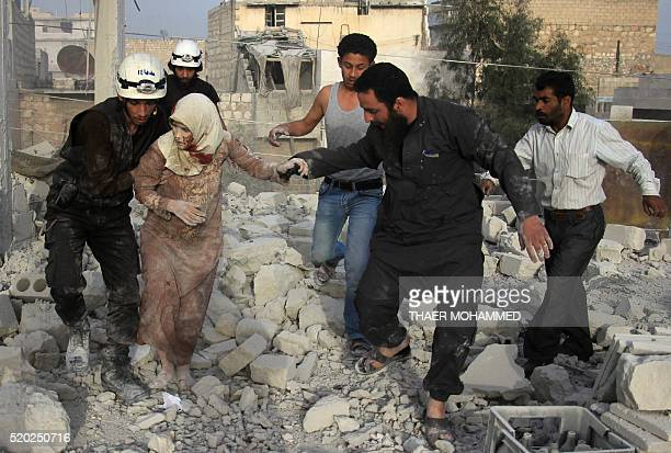 Syrian rescue workers and residents help an injured woman following a reported air strike by government forces on the rebelheld neighbourhood of...