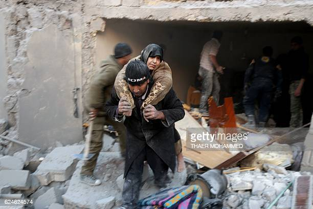 Syrian rescuer carries a woman who was rescued from the rubble of a building ffollowing reported airstrikes on Aleppo's rebelheld district of alHamra...