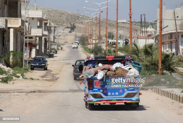Syrian residents of Khan Sheikhun flee on April 7 2017 the area of a suspected chemical weapons attack on their town earlier this week that killed...
