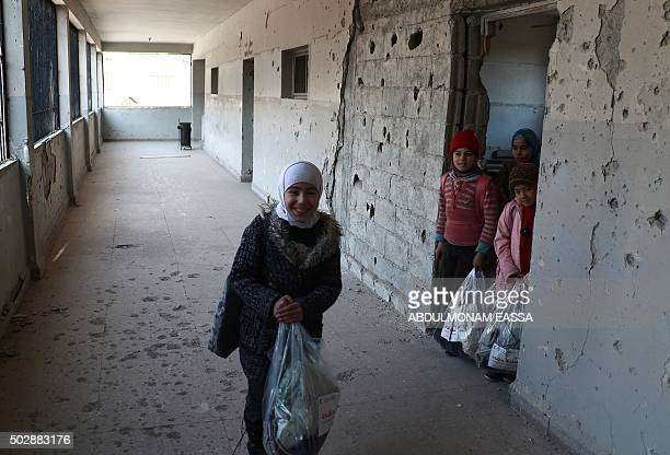 Syrian school girls are seen in their shrapnelriddled school in Irbin in the rebelheld region of Eastern Ghouta on the outskirts of the Syrian...