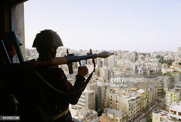 Syrian soldier overlooks Beirut with a rocket-propelled grenade launcher. Syrian troops went to Lebanon to keep order between several warring...