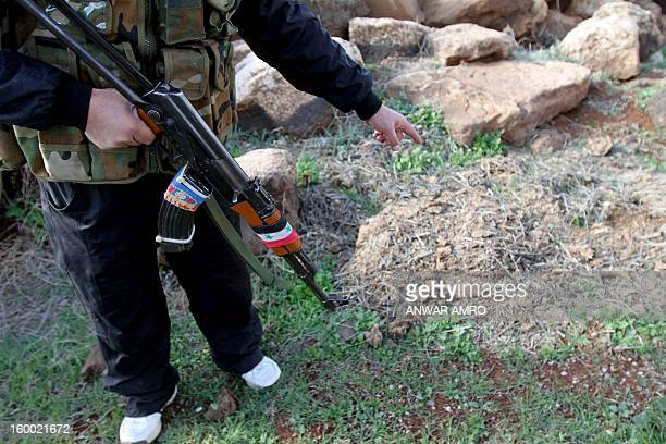 Syrian soldier points at a spot where the brotherinlaw of slain AlQaeda in Iraq leader Abu Musab alZarqawi Mohammad Jarad was believed to have been...
