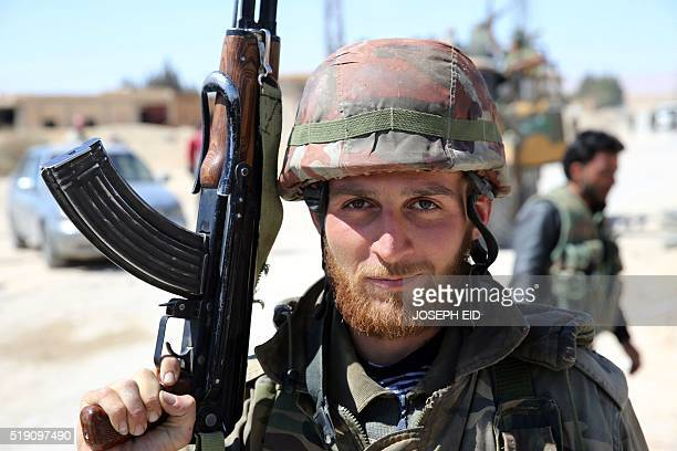 A Syrian soldier poses for a picture on April 4 2016 in alQaryatain a town in the province of Homs in central Syria after Syrian troops regained...