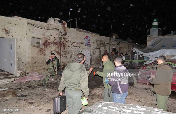 Syrian soldiers gather at the site of an attack in Kafr Sousa southwest of the Syrian capital Damascus on January 12 2017 State news agency SANA said...