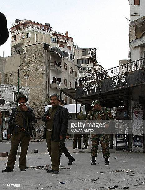 Syrian soldiers guard a street in the port city of Latakia 350 km northwest Damascus on March 27 where armed gangs have taken positions on rooftops...