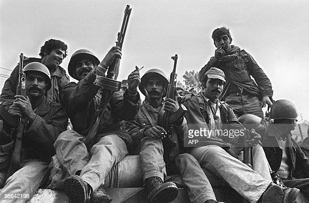 Syrian soldiers members of the joint Arab green helmets peacekeeping force to Lebanon atop a Russianmade tank take position 15 November 1976 in...